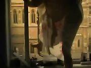 Voyeur vídeo de una chica masturbándose en el balcón